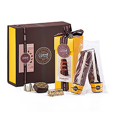 This Corné Port-Royal gourmet chocolate gift set offers a delicious collection of indulgences for the true chocolate enthusiast. Enjoy pralines, truffles, and the best hot chocolate.
