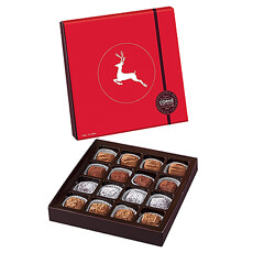 This Corné Port-Royal gift box wrapped in festive colors and a festive reindeer combines unique and exclusive recipes of the traditional truffle filled with butter cream, which subtly combines the power of dark chocolate and the delicacy of sweet, light flavors.