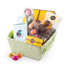 An irresistible collection of Easter chocolate is hand packed in a cute spring green egg hunting basket.