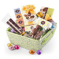 A wonderful collection of chocolate Easter eggs, Belgian chocolate pralines, and more is presented in a charming spring green basket.